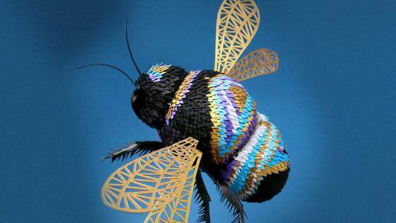 3D hand-cut paper sculptures of birds, bees, and other creatures